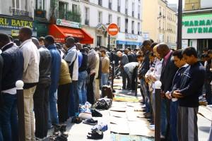 Muslims pray on the streets of Paris.