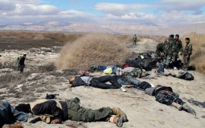 Syrian soldiers inspect the bodies of opposition fighters after an army ambush in the eastern Ghouta area of Damascus, in a photograph distributed by Syria's national news agency, SANA, on Feb. 26. /SANA