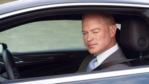 Neal McDonough winks in Cadallac commercial
