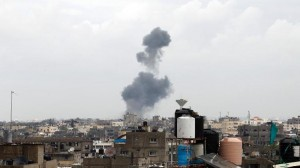 Smoke rises following an Israeli air strike on the southern Gaza town of Rafah on March 13.  /AFP/Said Khatib