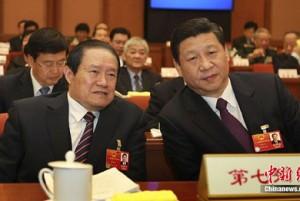 Zhou Yongkang, left, and Xi Jinping