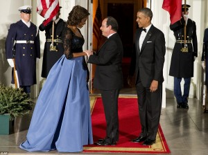 First Lady Michelle Obama greets French President Francois Hollande to a state dinner in his honor at White House in February.  /AP