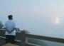 North Korean leader Kim Jong-Un watches a missile test.