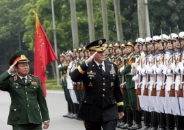 U.S. Chairman of the Joint Chiefs of Staff, Gen. Martin Dempsey and Vietnamese Chief of General Staff of the Army, Lt. Gen. Do Ba Ty in Hanoi, Vietnam on Aug. 14.  /Tran Van Minh/AP
