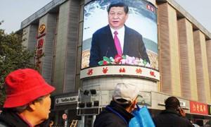 A screen at a Beijing junction shows a speech by Xi Jinping.  /Wang Wei/EPA