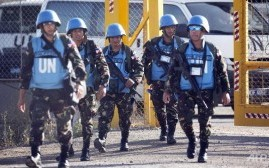 UN peacekeepers from the Philippines enter the Israeli sector of the Golan Heights on June 12, 2013.  /Menahem Kahana/AFP