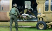 Soldiers in Beersheba, Israel, unload a Israeli comrade wounded in shootout on the border with Egypt. / Dudu Grunshpan / AP
