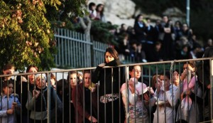 Israelis near funeral of Aryeh Kopinsky, Calman Levine and Avraham Shmuel Goldberg in Jerusalem, Nov. 18. / AFP