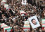 Iranians honor the memory of Hassan Moghadam, with coffins and photos after his death in a military base blast. / Reuters