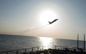 A Russian Su-24 attack aircraft sweeps low over the USS Donald Cook. /Reuters