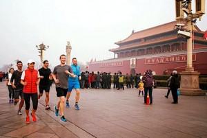 Facebook founder Mark Zuckerberg jogs through Tiananmen Square in Beijing. / Facebook