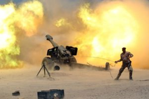 A member of the Iraqi security forces fires artillery during clashes with Isis militants near Fallujah on May 29. /Reuters