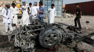 Civilians gather at the site of a car bomb attack in Samawah on May 1. /Reuters