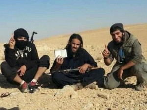 Raphael Hostey (centre), 23, left Manchester to join Isis in 2013. /Twitter