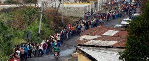Long lines at grocery store in Venezuela.