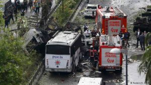 Fire engines stand beside a Turkish police bus which was targeted in a bomb attack in Istanbul. /Reuters