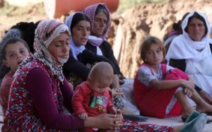Yazidis, who fled their homes when Islamic State militants attacked the town of Shingal. /AP file