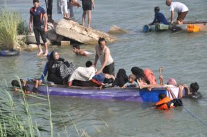 Civilians from Fallujah cross the Euphrates River to escape ISIL. /AP