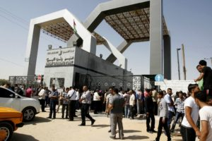 Palestinians wait at the Rafah border crossing. /Abed Rahim Khatib/Flash90