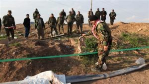 A mass grave contiaing 400 bodies was discovered near Fallujha.