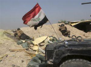 Iraqi counterterrorism forces face off with Islamic State militants in the Nuaimiya neighborhood of Fallujah. /AP