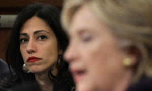 Huma Abedin and Hillary Clinton. /Getty Images