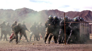 A unit from the Chinese People's Armed Police (PAP) participates in a drill with riot gear at a military base in Shigatse. / Reuters