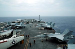 F/A-18 Hornet fighter jets and E-2D Hawkeye plane are seen on the U.S. aircraft carrier John C. Stennis during joint military exercise called Malabar, with the United States, Japan and India participating, off Japan's southernmost island of Okinawa. /Reuters/Nobuhiro Kubo