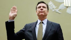 FBI Director James Comey is sworn-in before a House Oversight and Government Reform Committee hearing on July 7. /Yuri Gripas/AFP/Getty Images