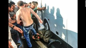 Civilians beat a Turkish soldier who participated in the attempted coup. /AP