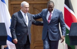 Prime Minister Binyamin Netanyahu (L) and Kenyan President Uhuru Kenyatta walk together after giving a joint press conference at State House in Nairobi, Kenya on July 5. /AP/Sayyid Abdul Azim