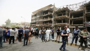 Iraqis near site of blast in Baghdad's Karrada shopping mall. / Reuters