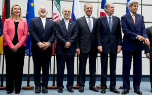 European Union's Federica Mogherini, Iranian Foreign Minister Mohammad Javad Zarif, Head of the Iranian Atomic Energy Organization Ali Akbar Salehi, Russian Foreign Minister Sergey Lavrov, British Foreign Secretary Philip Hammond and U.S. Secretary of State John Kerry announce the Iran Nuclear Agreement in Vienna. / Joe Klammar / AFP