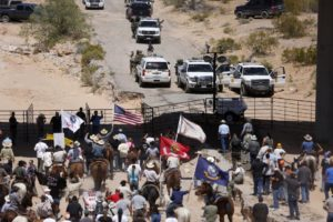 Protesters gather at the Bureau of Land Management's base camp, where cattle that were seized from rancher Cliven Bundy are being held, near Bunkerville, Nevada April 12, 2014. /Reuters