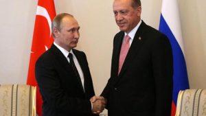 Russian President Vladimir Putin (R) greets Turkish President Recep Tayyip Erdogan during their meeting in Konstantin Palace, August,9, 2016 in Strenla, Saint Petersburg. /Mikhail Svetlov/Getty Images