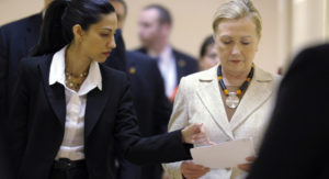 Huma Abedin and Hillary Clinton. /AP