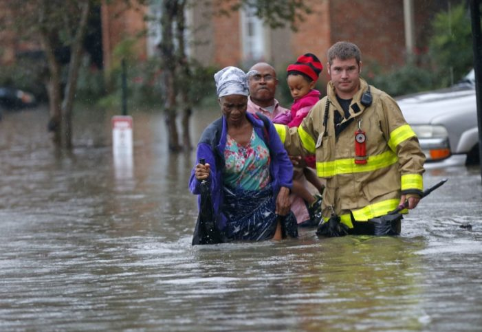 Trump heads to flood-ravaged Louisiana while Obama vacations and Hillary rests