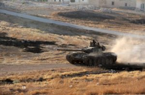 Syrian opposition fighters drive a tank on the southern outskirts of Aleppo. /AFP