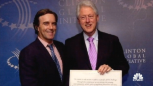 Claudio Osorio and Bill Clinton