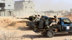 Pro-Libyan government forces fire on ISIL positions in Sirte. /Reuters