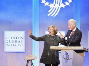 Hillary Clinton and former President Bill Clinton address the audience during the Opening Plenary Session: Reimagining Impact for the Clinton Global Initiative on Sept. 22, 2014. /Getty Images