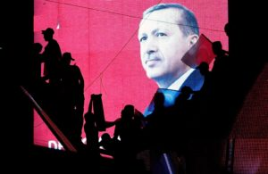 Supporters of Turkey's Erdogan silhouetted against a screen with his image. / Baz Ratner / Reuters