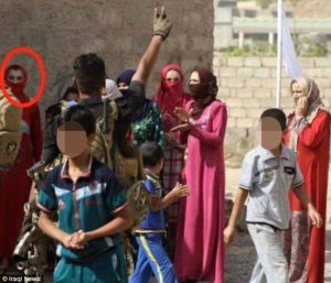 ISIL's Abu Omar al-Assafi, circled, was caught trying to sneak out of an Iraqi town in drag. /Iraqi News