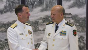 Adm. John Richardson with Chinese naval commander Adm. Wu Shengli in Beijing on July 18.