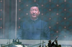 Making like Mao: Xi Jinping is said to be relying on two main weapons to ensure socio-political stability: upbeat propaganda and no-holds-barred crackdown on dissent. / Ng Han Guan / AP