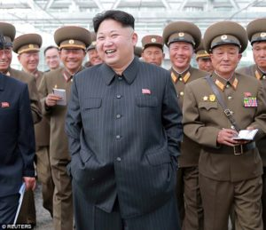 Kim Jong-Un and North Korean officers.