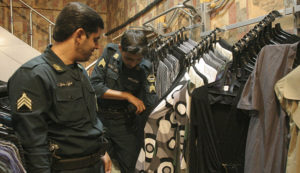 Iran's religious police with samples of inappropriate women's clothing. / Reuters