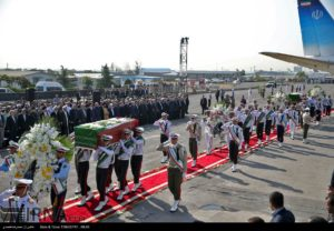 Iranian honor guard carries caskets of pilgrims, killed in a crush at the annual Hajj pilgrimage, on Oct. 3, 2015 at Tehran's Mehrabad Airport.