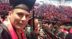 Robin Shahini in a family photo of his graduation ceremony from San Diego State University.