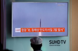A passenger watches a TV screen broadcasting a news report on North Korea firing three ballistic missiles into the sea off its east coast, at a railway station in Seoul, South Korea, Sept. 5. /Reuters/Kim Hong-Ji